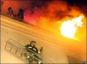 Firefighter approaches blazing hotel