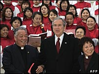 President Bush with the choir and officials of Gangwashi Church in Beijing