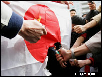 Chinese demonstrators burn a Japanese flag