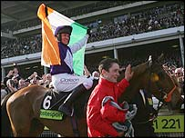 Barry Geraghty celebrates winning the Cheltenham Gold Cup on Kicking King