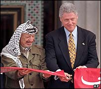 Yasser Arafat and Bill Clinton