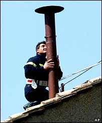 Worker putting up the chimney