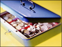 Money in cash box, BBC/Corbis