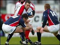 Kevin Maggs tries to gain ground for Ulster