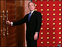 President Bush makes a face as he tries to leave locked door