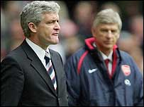 Arsenal boss Arsene Wenger (right) looks on as Mark Hughes barks orders out to his players