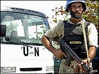 A Pakistani UN peacekeeper guards the UN delegation bus in Haiti