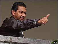 Ecuador's President Lucio Gutierrez gestures to reporters