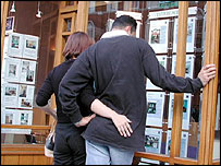 Couple looking estate agent's window