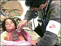 A young Afghan girl, injured in the 2002 earthquake, being treated by a doctor from Medecins Sans Frontiers