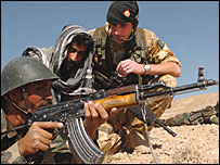 A soldier of the Afghan National Army getting training from British forces (photo by Johnny Green/PA)