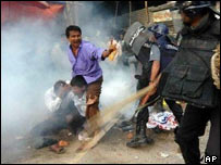Riot police beat up a group of opposition activists during a rally in Dhaka