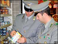 Italian forest rangers examine Nestle baby milk cartons (Corps of Forest Rangers photo)
