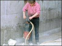 Image of a man drilling