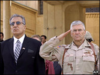 Zalmay Khalilzad and Gen George Casey at the handover of a Tikrit palace