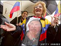 A woman in Massachusetts wears a T-shirt of Hugo Chavez as an oil deal is signed