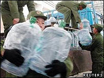 Chinese soldiers transfer drinking water to a warehouse in Harbin