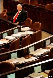 Israeli Prime Minister Ariel Sharon sits alone in the Knesset
