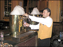 Barman pours a glass of draught Brahma beer at Bar Brahma