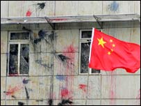 Chinese flag is hoisted in front of the eggs- and paint- stained Japanese consulate, Monday April 17, Shanghai