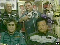 Astronaut Leroy Chiao (bottom right)
