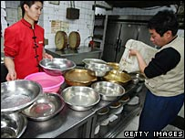 Restaurant workers stock up on water before pollution reaches the Chinese city of Harbin
