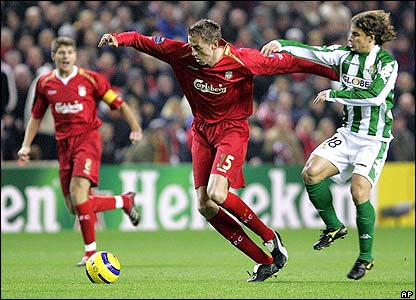 Peter Crouch battles for the ball