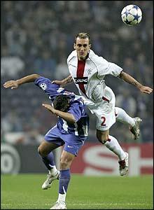 Rangers midfielder Fernando Ricksen dominates in the air