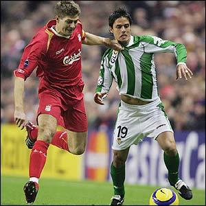 Liverpool's captain Steven Gerrard battles with Oscar Lopez