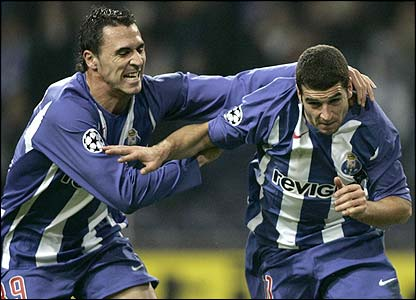 Porto's Hugo Almeida congratulates Lisandro Lopez