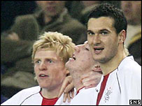 Chris Burke celebrates with Ross McCormack and Ian Murray