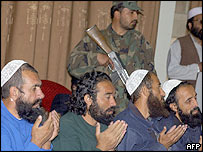 Freed Guantanamo prisoners after their arrival in Afghanistan