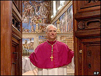 Archbishop Piero Marini closes the door of the Sistine Chapel for the conclave