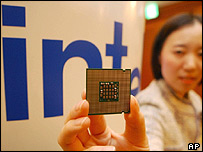 An Intel employee shows off one of the firm's latest processors