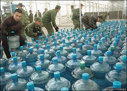 Chinese soldiers distribute bottled water