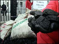 Greenpeace campaigners dumping coal outside Downing Street