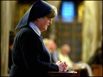 A nun prays at Westminster Cathedral