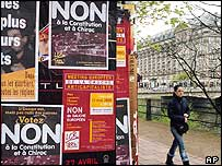 French woman walks past posters for the Non campaign