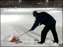 An Aviemore hotel worker sweeping snow