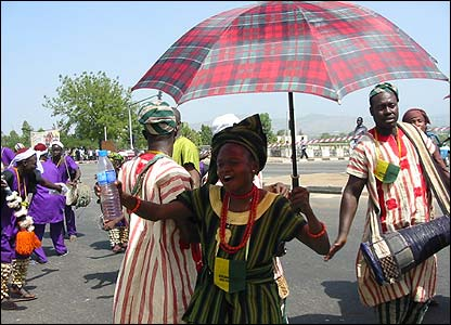 Yoruba woman with umbrella