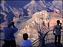 Tourists look out at the south rim of the Grand Canyon National Park