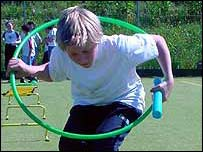 Boy with hula-hoop