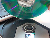 Blank CD being put in drive, BBC
