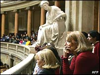 Women listen to debate in parliament