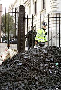Pile of coal dumped outside Downing St by protestors.  Image: AFP/Getty