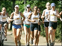 Kelly Holmes (centre) leads at training group of young athletes in South Africa