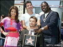 Simon Cowell (top) with Paula Abdul, Ryan Seacrest and Randy Jackson