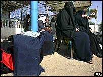 Palestinians waiting to cross into Egypt at Rafah