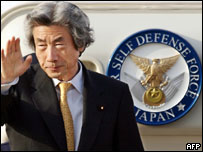 Junichiro Koizumi on board a plane taking him to the summit, 21 April