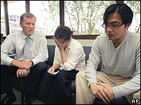 Van Nguyen's mother Kim Nguyen (centre) weeps as she meets an Australian official